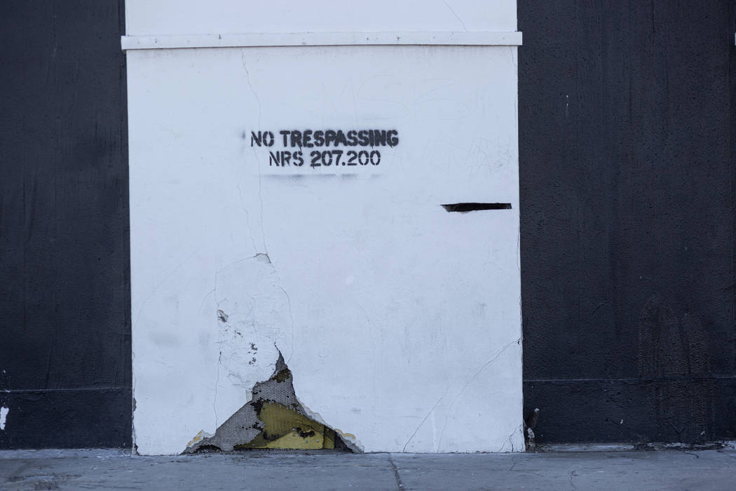 A no trespassing warning is shown on a wall outside the historic Huntridge Theater on Thursday, ...