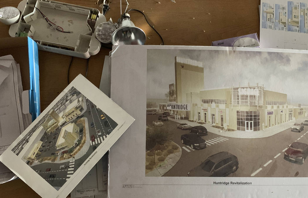 Renderings of a remodeled Huntridge Theater are scattered across a table inside the lobby of t ...