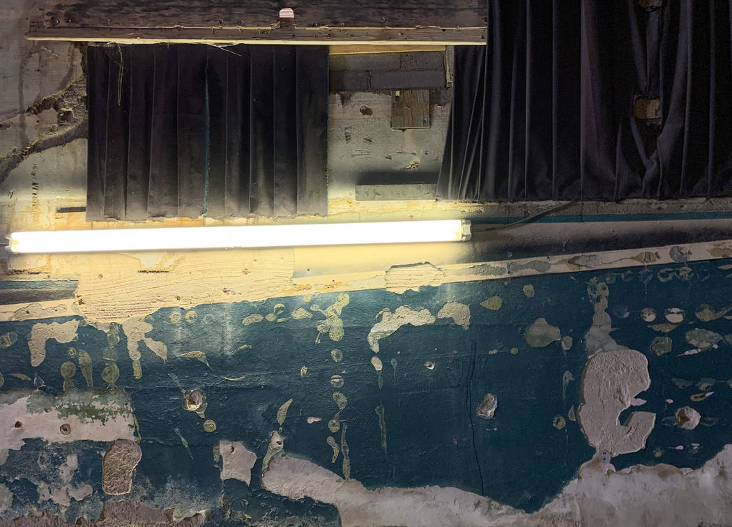Chipped paint and plaster covers the walls inside the historic Huntridge Theater on Thursday, O ...