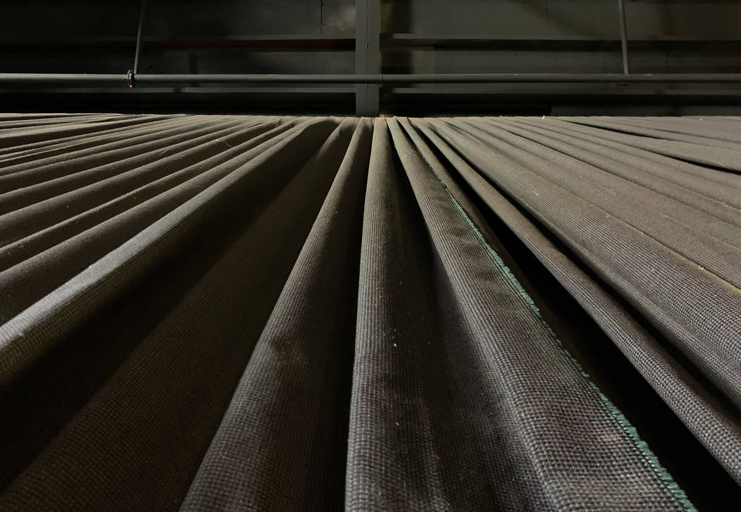 Dust covered soundproof curtains line the walls inside the historic Huntridge Theater on Thursd ...
