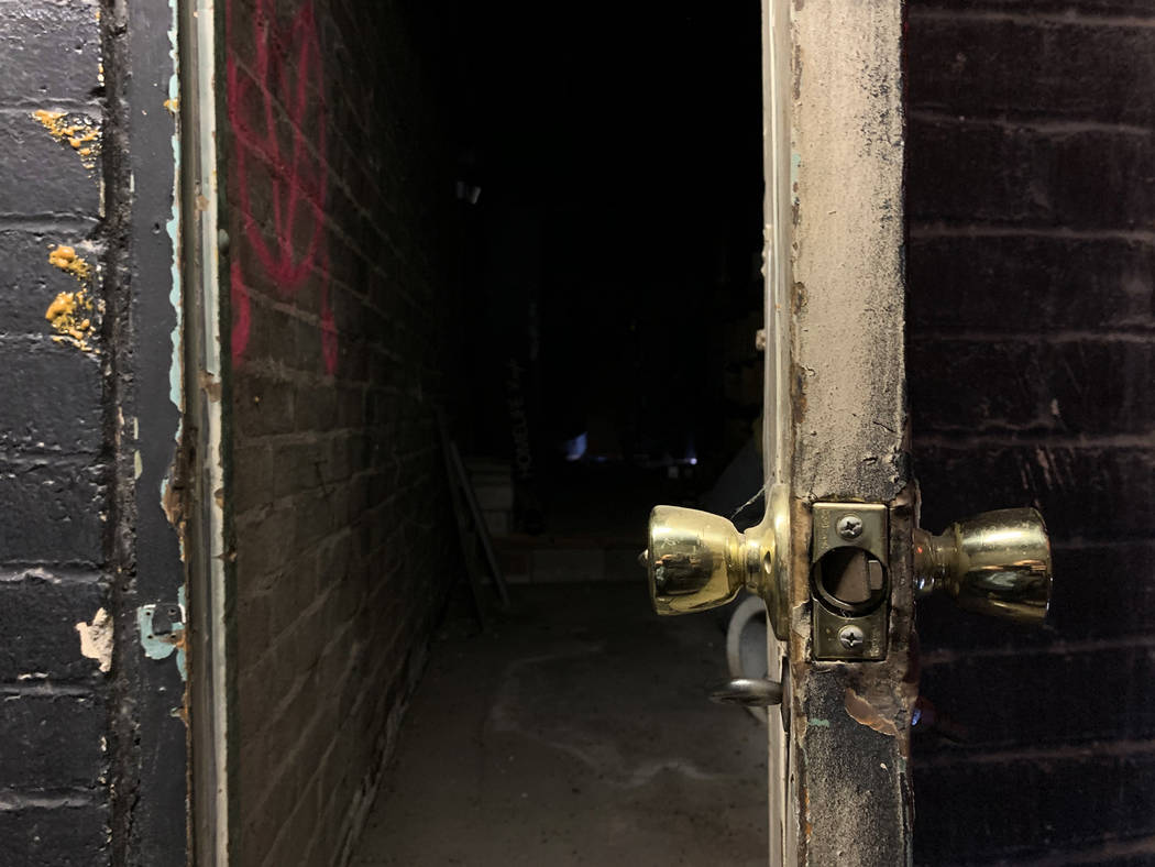 A doorway leads to an old bathroom inside the historic Huntridge Theater photographed on Thursd ...
