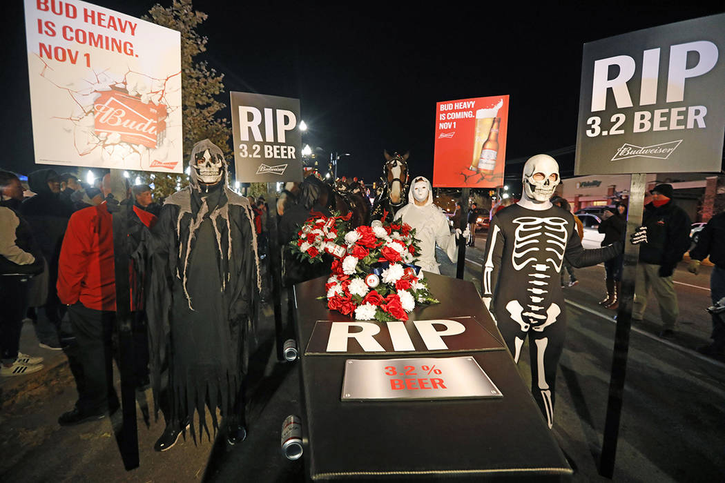 A ghoulish group of pallbearers stand in front of a casket representing 3.2% beer, Wednesday, O ...