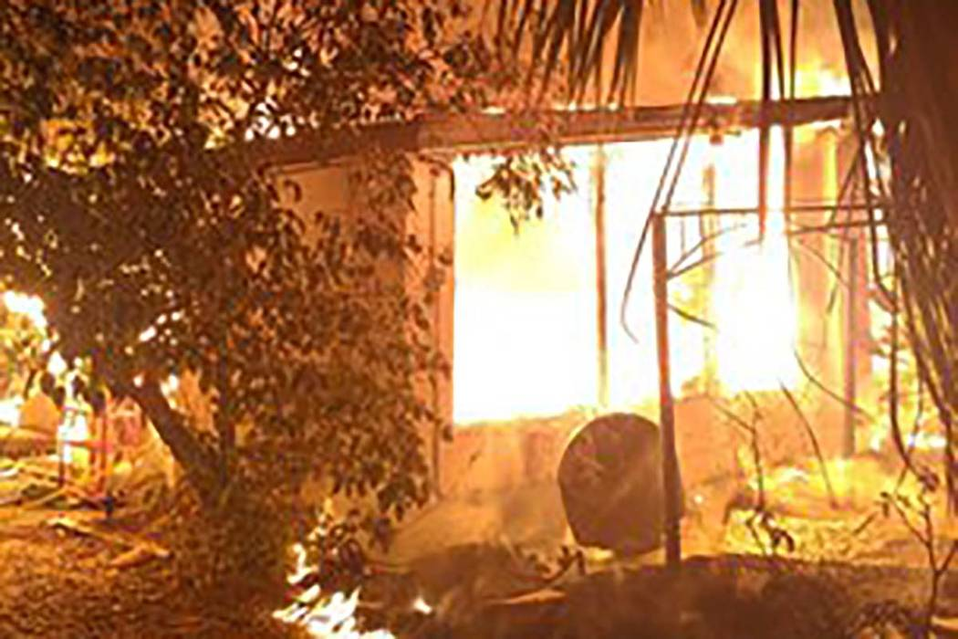 Two people were displaced in a two-alarm fire at 1403 South 6th St. not far from downtown Las V ...