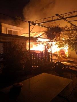 Arriving Las Vegas Fire Department firefighters reported a residence fully involved in flames w ...