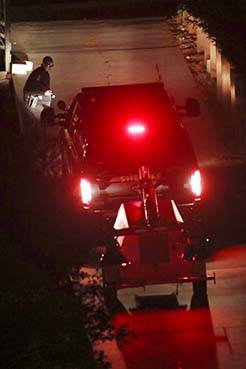 Contra Costa County Sheriff deputies investigate a multiple shooting in Orinda, Calif., on Thur ...