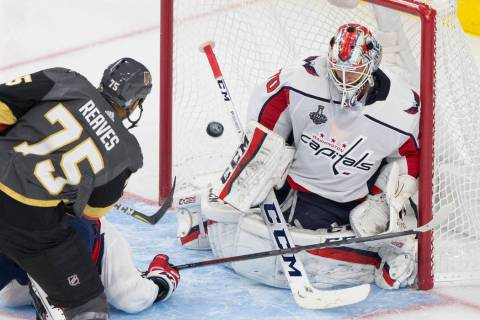 Golden Knights right wing Ryan Reaves (75) scores a third-period goal against Capitals goaltend ...
