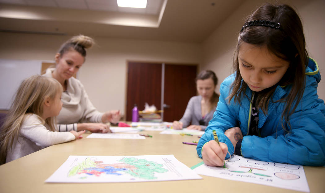 """Daria Alulema, 8, during a """"Fun to Play"""" session at Alexander Library in North Las Ve ..."""