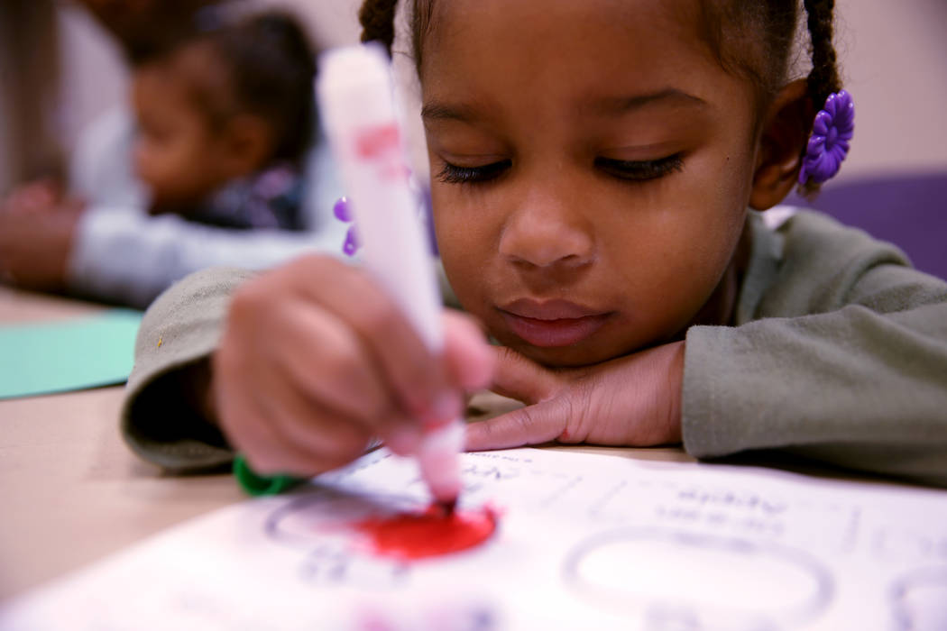"""Loriella Keyes, 3, during a """"Fun to Play"""" session at Alexander Library in North Las V ..."""