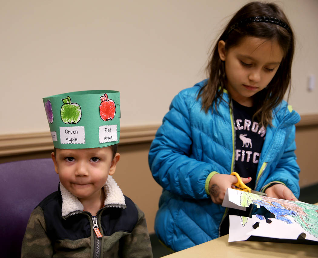 """Ivan Alulema, 3, dons the """"life cycle hat"""" he made with his sister Daria Alulema, 8, ..."""