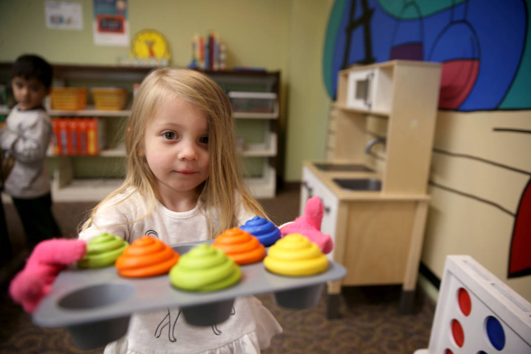 Hartley Tavano, 3, offers cupcakes at Alexander Library in North Las Vegas Friday, Nov. 1, 2019 ...