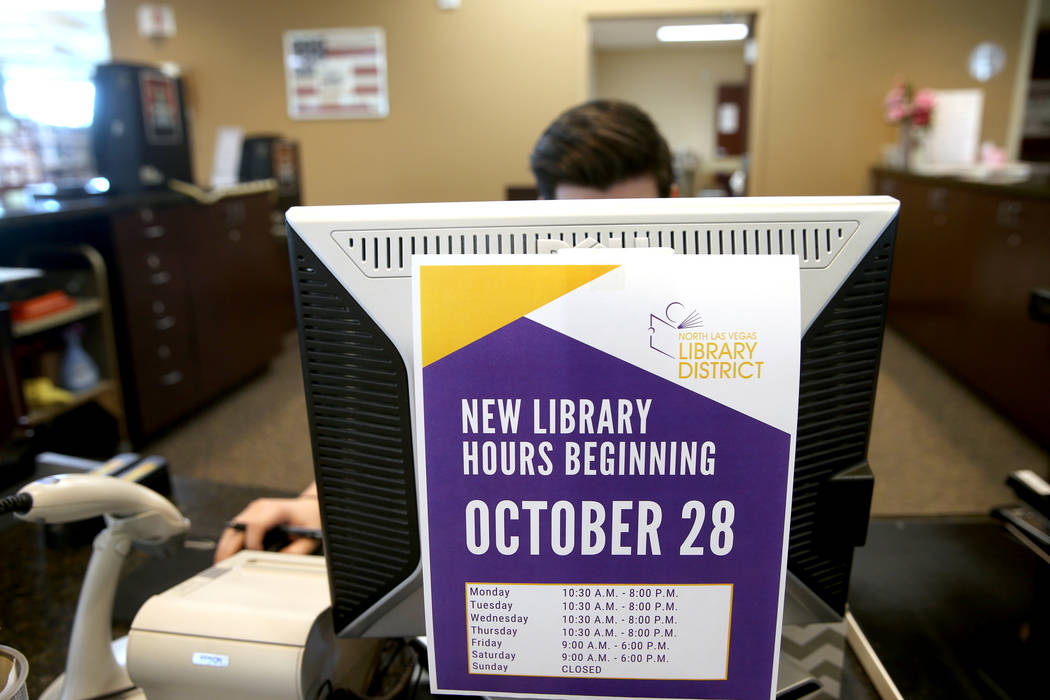 New hours are displayed at Alexander Library in North Las Vegas Friday, Nov. 1, 2019. (K.M. Can ...