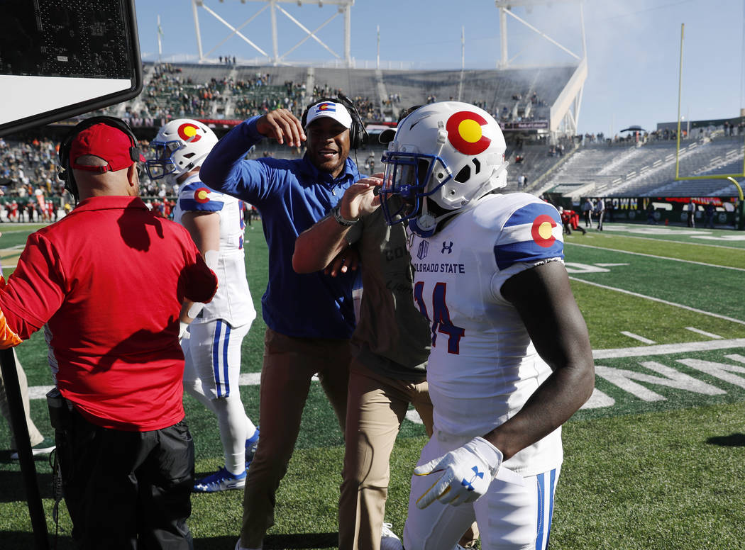 Colorado State kick returner Anthony Hawkins is congratulated after he ran back the opening kic ...