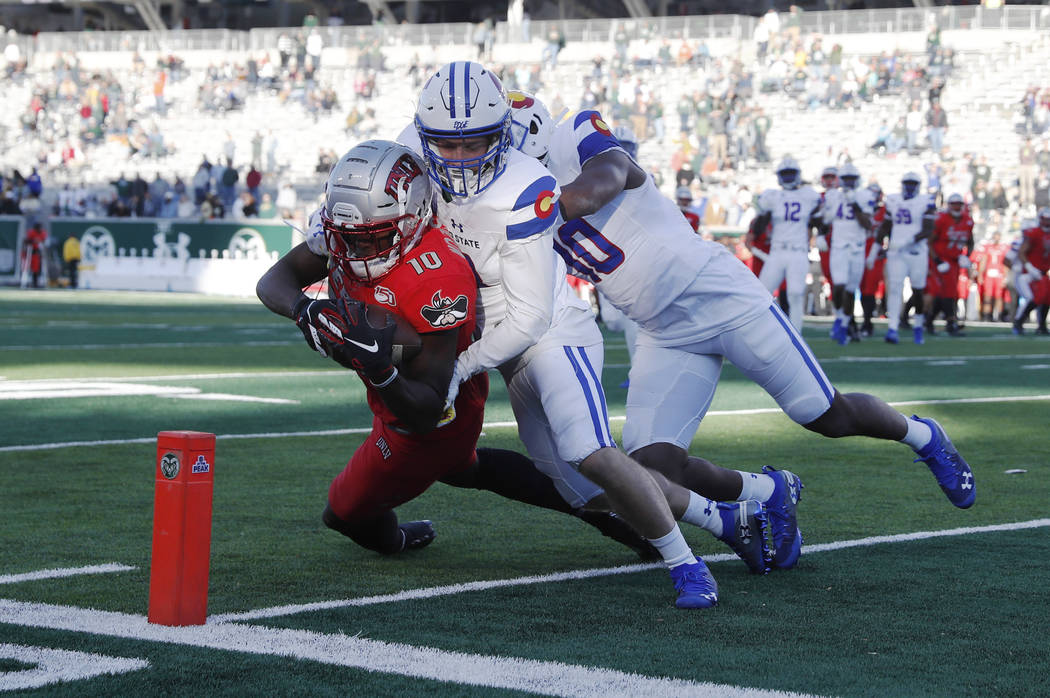UNLV wide receiver Darren Woods Jr. tumbles into the end zone for a touchdown after catching a ...