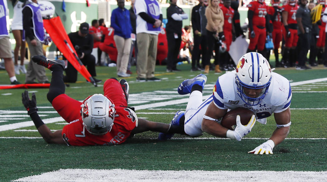 Colorado State running back Christian Hunter scores a touchdown against UNLV defensive back Jer ...