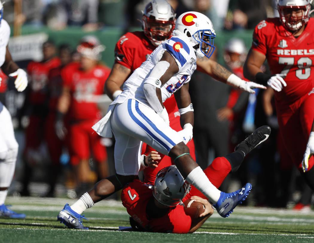 Colorado State safety Logan Stewart, front, reats after sacking UNLV quarterback Kenyon Oblad i ...