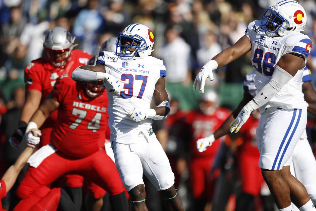 Colorado State safety Logan Stewart, left, celebrates with defensive lineman Ellison Hubbard af ...