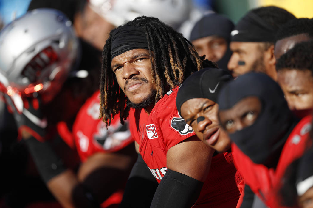 UNLV defensive back Evan Austrie joins teammates on the bench watching the clock as time winds ...