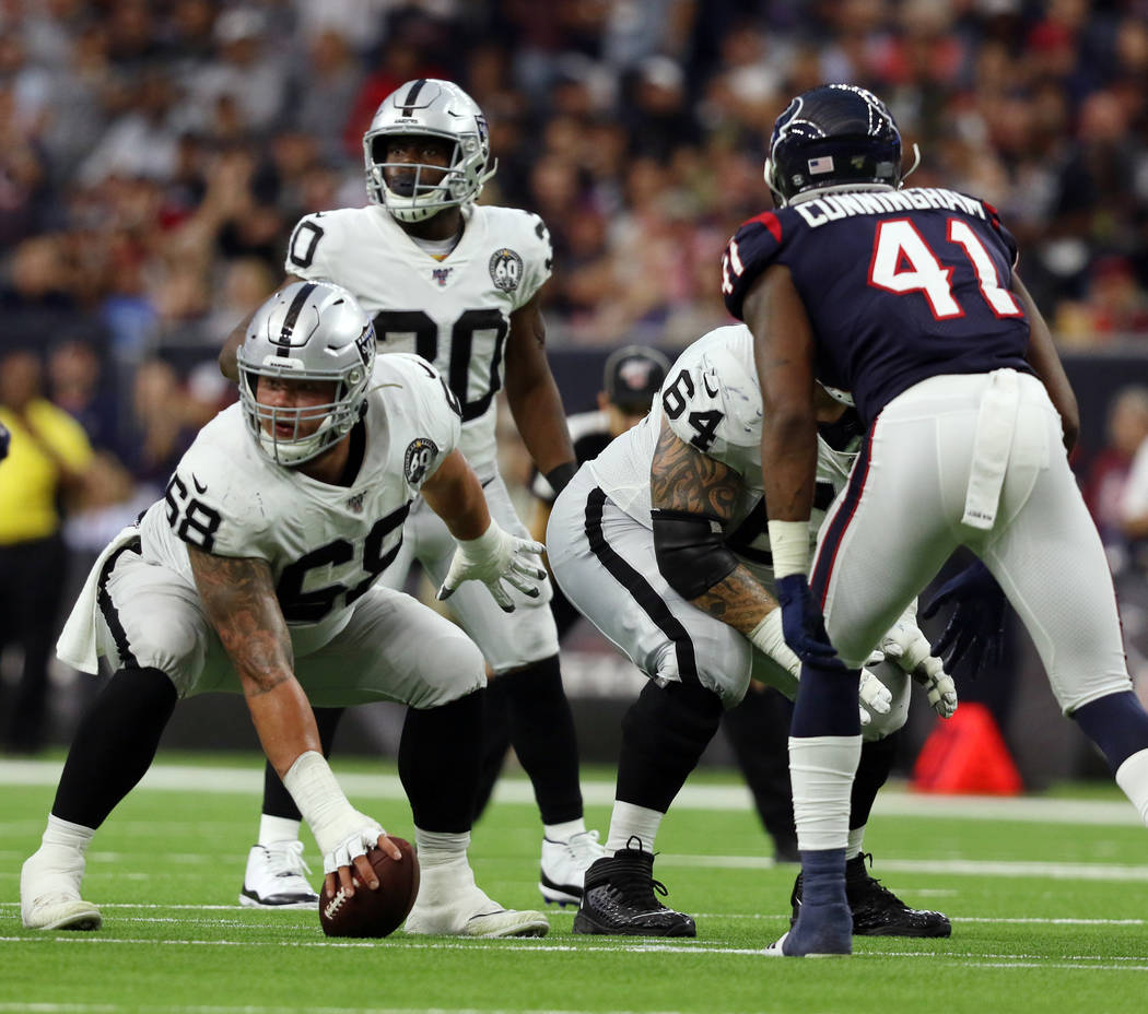 Oakland Raiders offensive tackle Andre James (68) prepares to hike the football after replacing ...