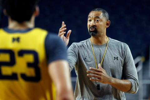 Michigan head coach Juwan Howard directs his team during NCAA college basketball practice in An ...