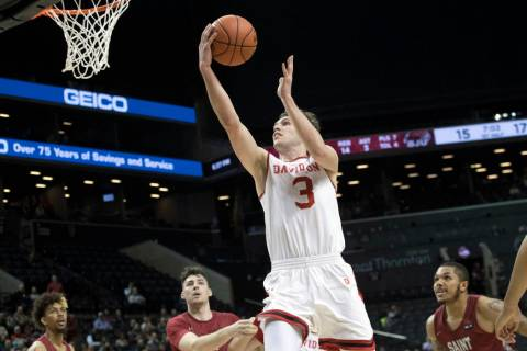 Davidson guard Jon Axel Gudmundsson (3) goes to the basket during the first half of the team's ...