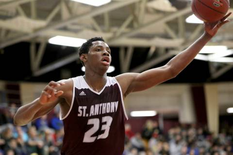 St. Anthony's Charles Bassey (23) in action against Hudson Catholic during a high school basket ...