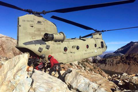 Crews work to recover the bodies of two hikers who died on Red Slate Mountain in California's e ...