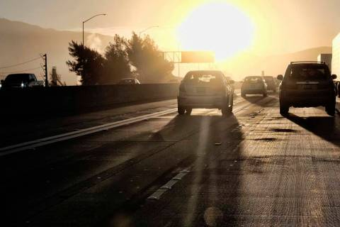 Commuters drive into downtown Los Angeles as the sun rises along Interstate 5 in 2018. (Richard ...
