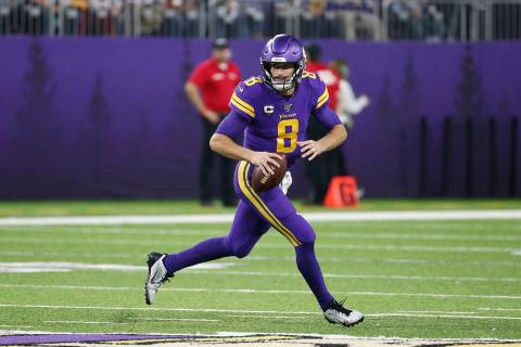 Minnesota Vikings quarterback Kirk Cousins (8) throws a pass during the second half of an NFL f ...