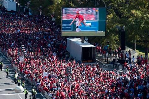 Fans wait for the MLB Washington Nationals to celebrate the team's World Series baseball champi ...