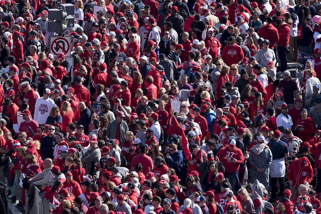 Fans wait for the start of the MLB Washington Nationals celebration of the team's World Series ...