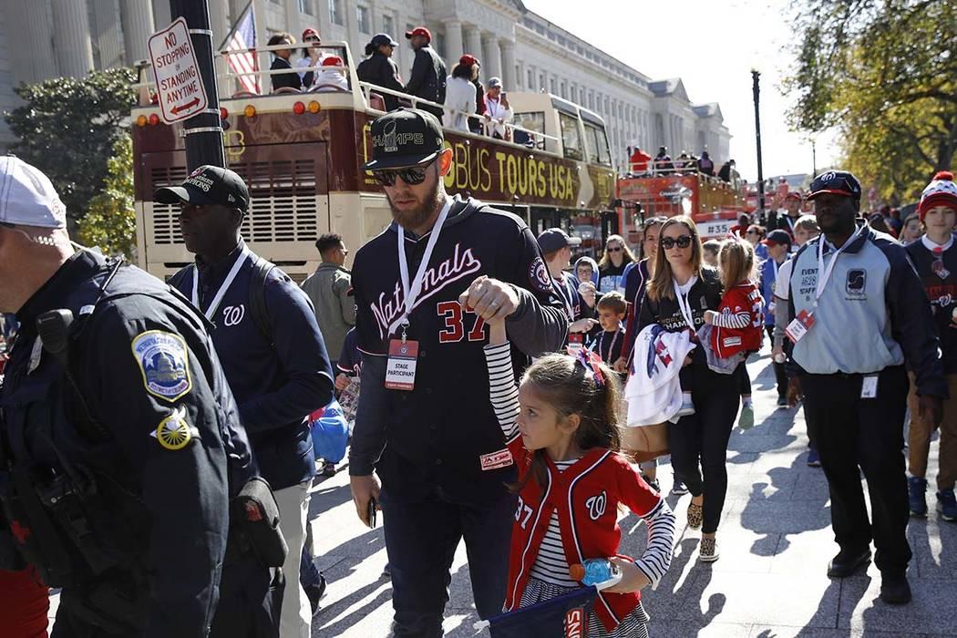 Washington Nationals starting pitcher Stephen Strasburg (37) arrives for a parade to celebrate ...