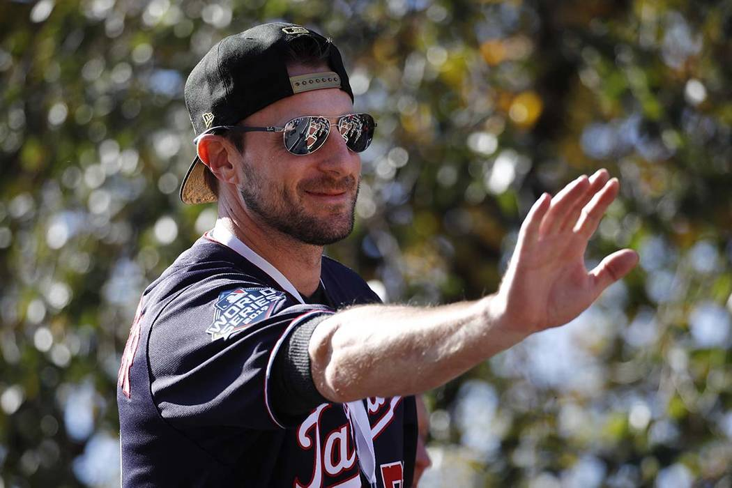 Washington Nationals starting pitcher Max Scherzer waves to fans before a parade to celebrate t ...