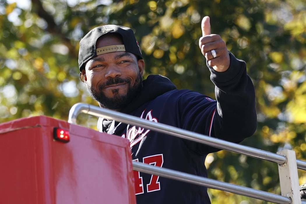 Washington Nationals second baseman Howie Kendrick gestures to fans before a parade to celebrat ...