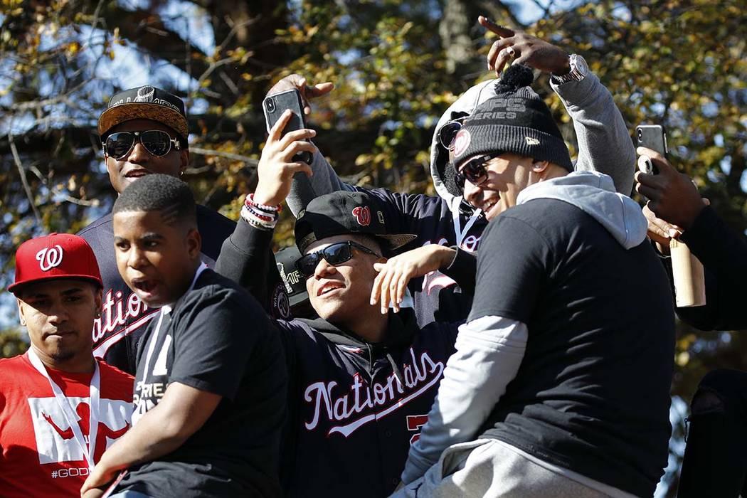 Washington Nationals left fielder Juan Soto, center, celebrates with teammates before a parade ...