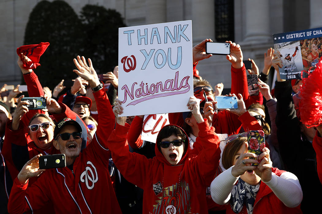 Washington Nationals fans cheer during a parade to celebrate the team's World Series baseball c ...