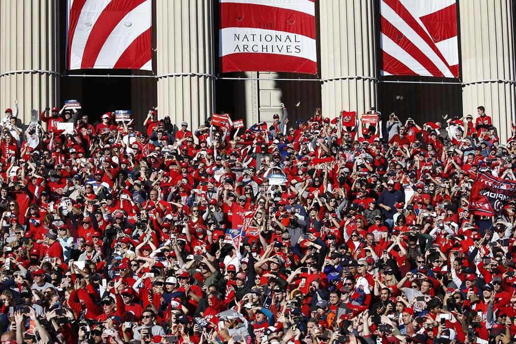 Washington Nationals fans gather on the steps of the National Archives during a parade to celeb ...
