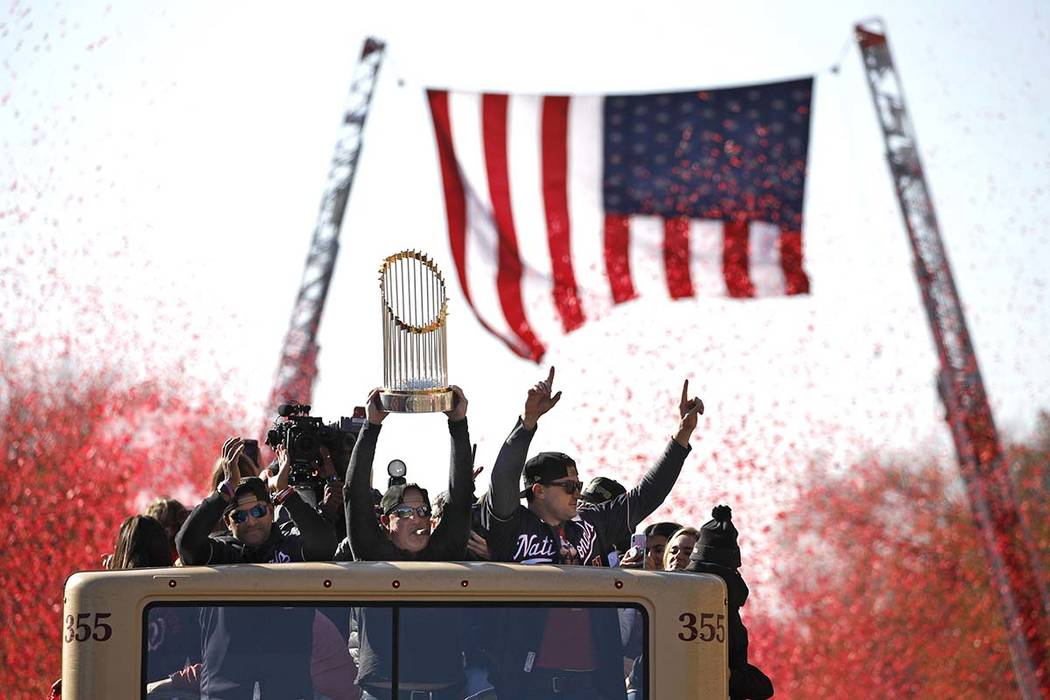 Washington Nationals general manager Mike Rizzo holds up the World Series trophy during a parad ...