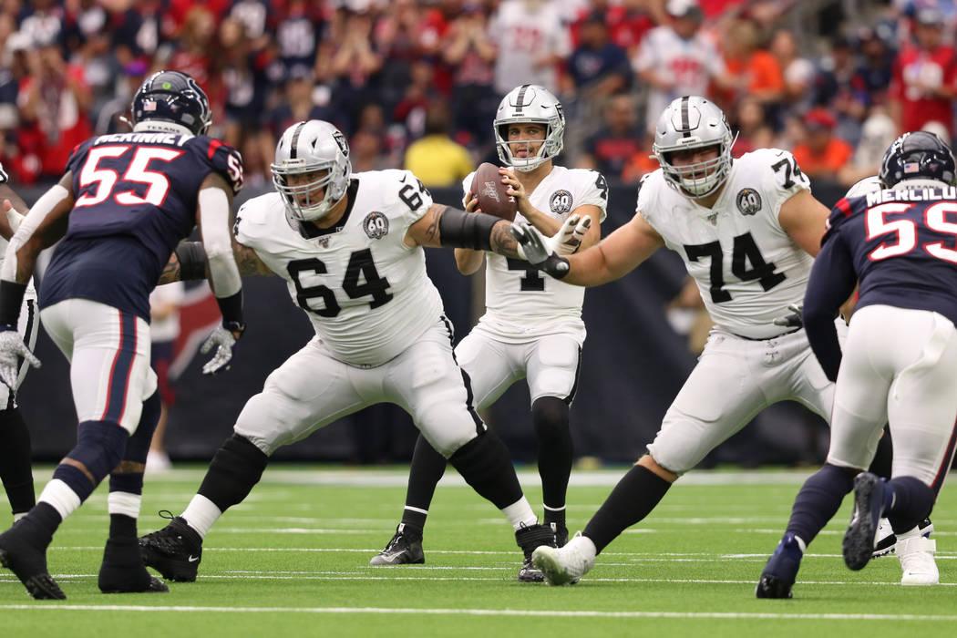 Oakland Raiders quarterback Derek Carr (4) drops back to pass as offensive guard Richie Incogni ...