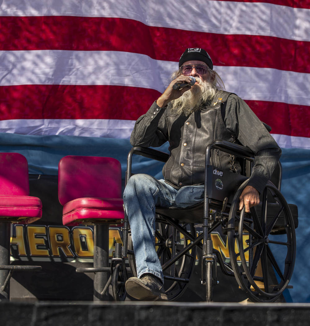 """Daniel """"Lt. Dan"""" Holman sings the National Anthem during the 10th Annual One Hero at ..."""