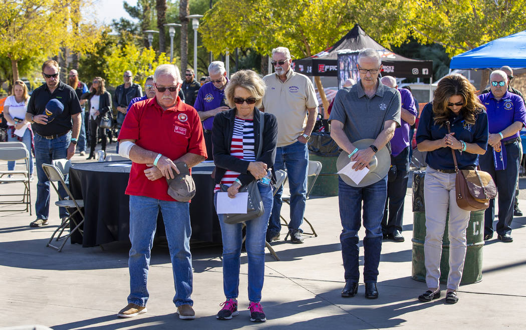 Attendees stand for a prayer following the National Anthem during the 10th Annual One Hero at a ...