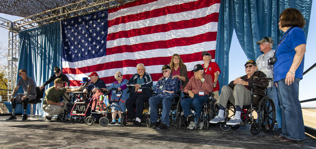 Rich Hillis with One Hero at a Time, left, talks with WWII and Korean War veterans during the 1 ...