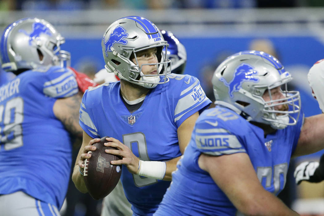 Detroit Lions quarterback Matthew Stafford looks downfield during the first half of an NFL foot ...