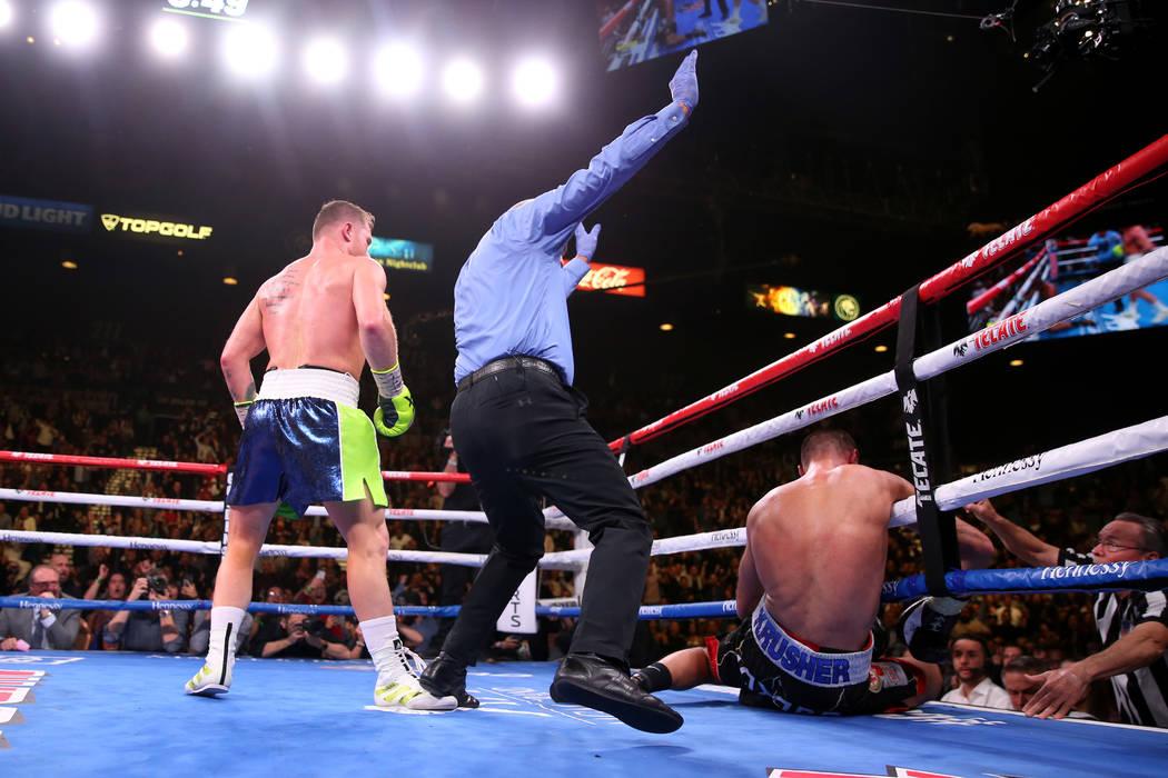 "Saul ""Canelo"" Alvarez, left, knocks out Sergey Kovalev during the 11th round of the WBO lig ..."