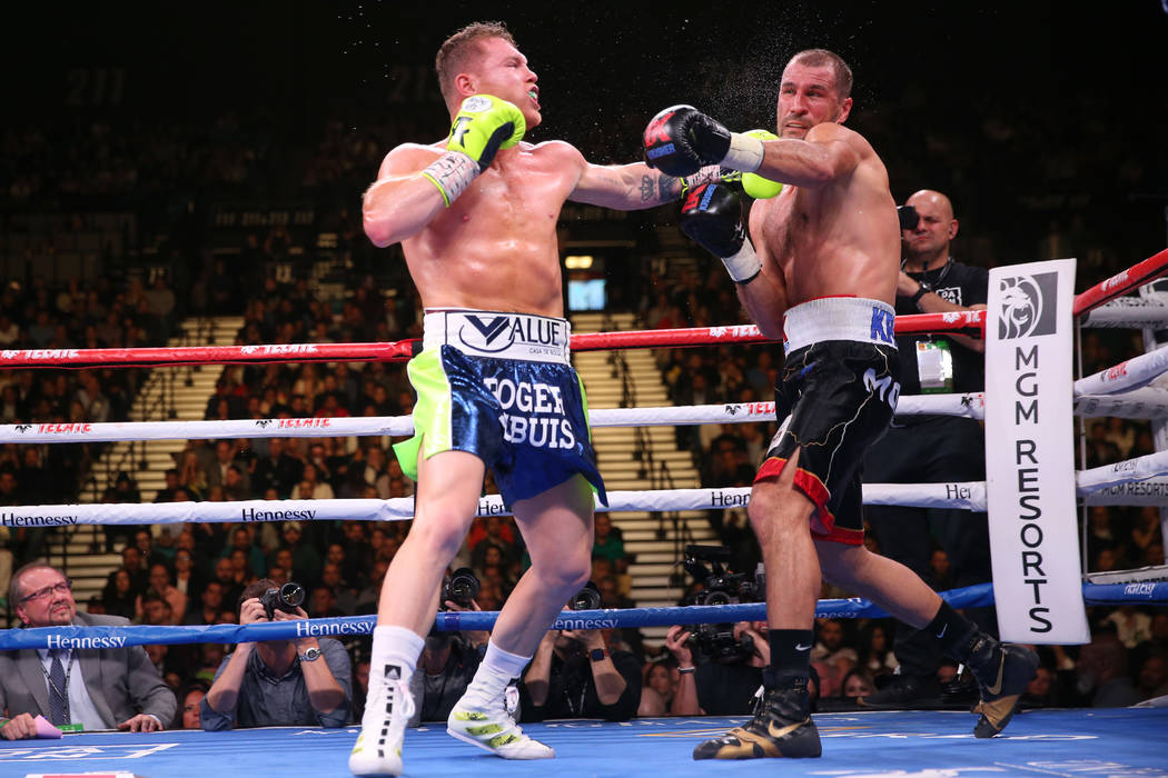 """Saul """"Canelo"""" Alvarez, left, connects a punch against Sergey Kovalev during the f ..."""