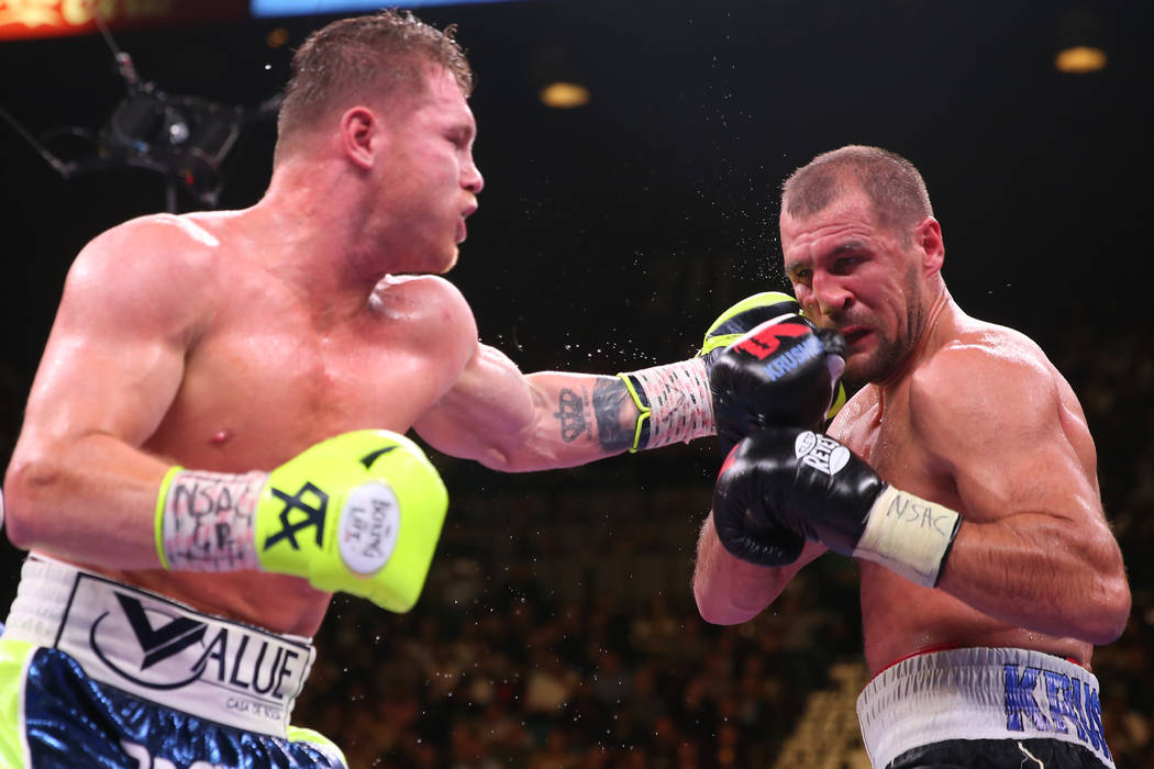 """Saul """"Canelo"""" Alvarez, left, connects a punch against Sergey Kovalev during the 1 ..."""