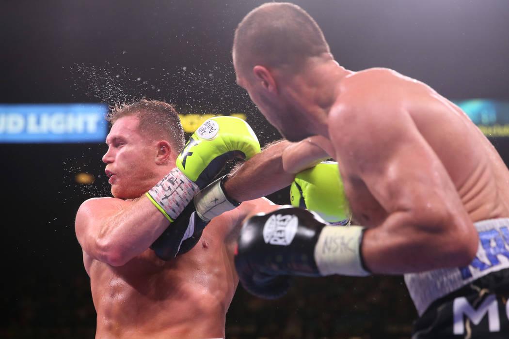"Saul ""Canelo"" Alvarez, left, takes a punch against Sergey Kovalev during the nint ..."