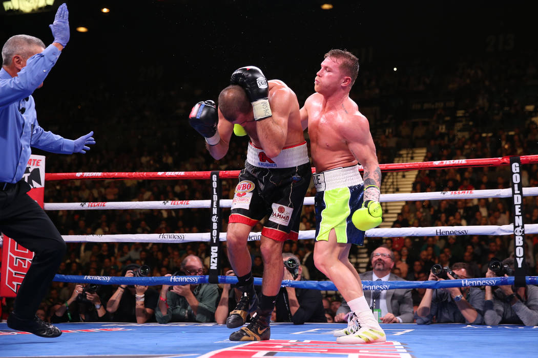 """Saul """"Canelo"""" Alvarez, right, gets ready for a punch against Sergey Kovalev durin ..."""