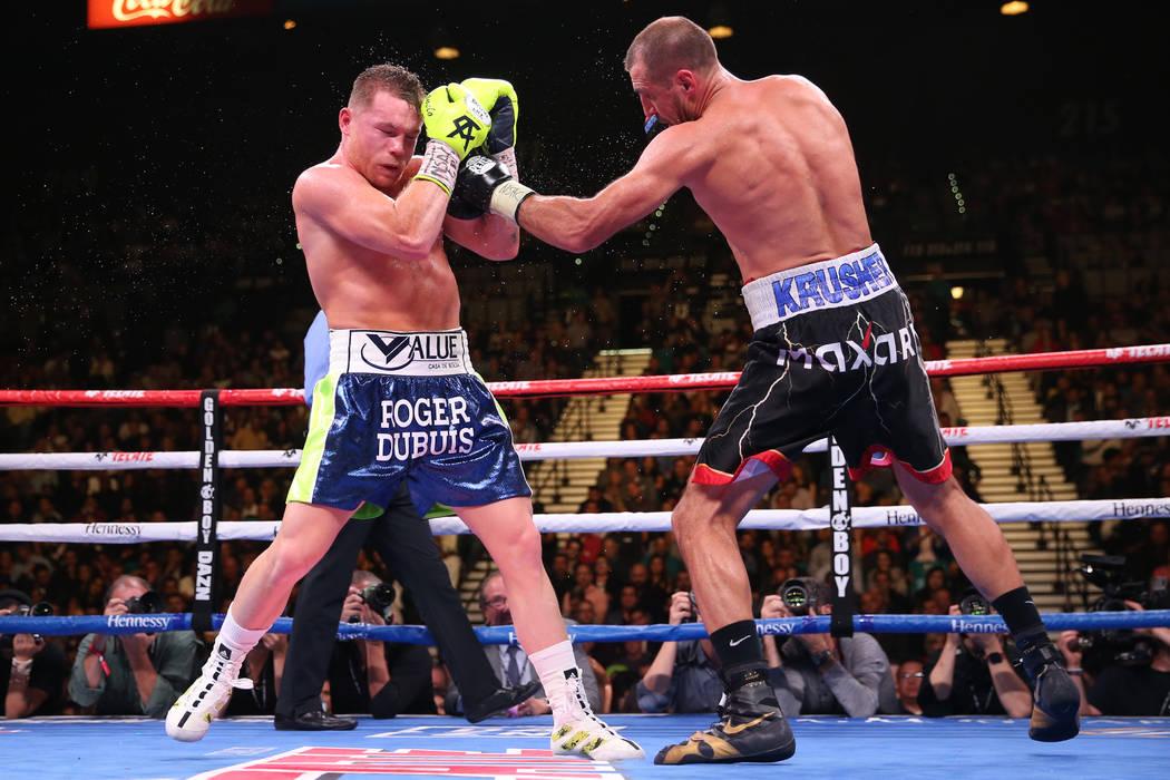 "Saul ""Canelo"" Alvarez, left, battles Sergey Kovalev during the ninth round of the ..."