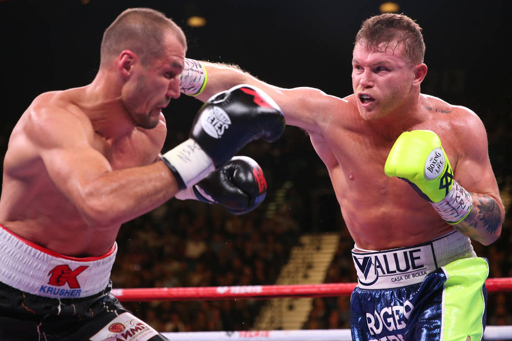 """Saul """"Canelo"""" Alvarez, right, throws a punch against Sergey Kovalev during the th ..."""