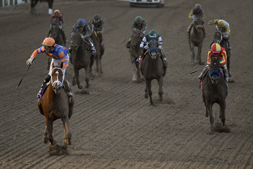 Irad Ortiz Jr., left, aboard Vino Rosso celebrates after winning the Breeders' Cup Classic hors ...